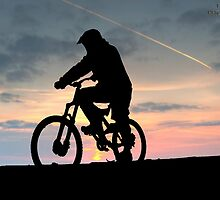 Silhouette of biker by dan williams