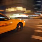 Blurred NYC taxi cab during the rush hour  by Anton Oparin