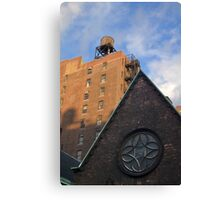 A buildings in New York City and rooftop with old water tower.  Canvas Print
