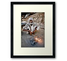 Man by fire Framed Print