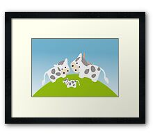 Cute happy cow family in meadow Framed Print