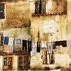 Drying laundry in mediterranean town. by cloud7