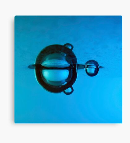 Water droplet forming bubbles underwater Canvas Print