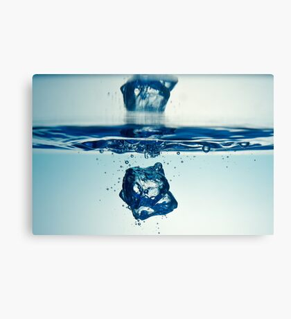 Droplet forming bubbles, underwater Canvas Print