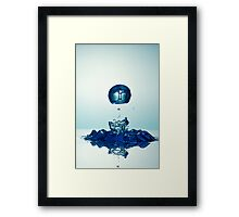 Splashing Droplet into water Framed Print