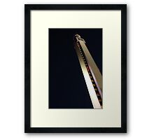 Tipping tower Framed Print