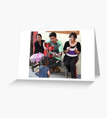 A musician entertaining his family. Greeting Card