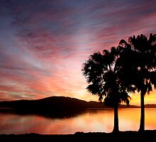 Tiona Sunset over lake and mountain by AdamRussell
