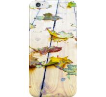 Closeup view on a wet green and yellow leaves iPhone Case/Skin