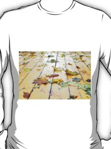 Closeup view on a wet green and yellow leaves T-Shirt