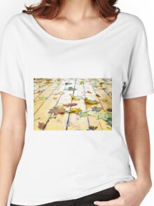 Closeup view on a wet green and yellow leaves Women's Relaxed Fit T-Shirt