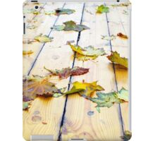 Closeup view on a wet green and yellow leaves iPad Case/Skin