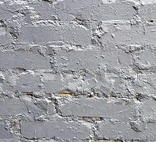 Fragment of a brick wall closeup with gray paint by vladromensky