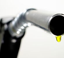 Oil drop coming out of petrol pump nozzle by Sami Sarkis