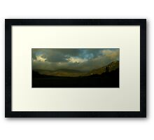 A storm brewing Framed Print