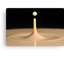 Drop of milk splashing into coffee Canvas Print