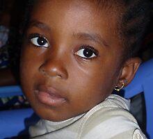 Bright eyes in Brazzaville, Republic du Congo by Baba John Goodwin