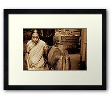 A Lady and a Cow Framed Print