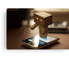 Danbo tries to use my iPhone Canvas Print