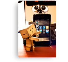 Danbo gets help from Wall•E using my phone Canvas Print