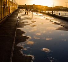 Sunset over the breakwater by Roger Neal