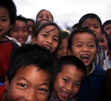 Smiling Laos kids. by Phil Bower