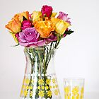 Bright Coloured Roses in a 60's Glass Jug by Anna Davies