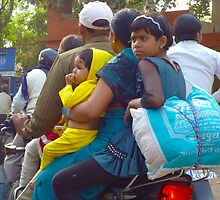 Family of 4 on a motorbike in India. by wehavegrown