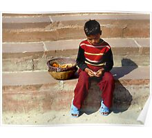 Sad boy sitting on steps of the Ghats in India. Poster