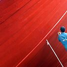 red boat and men at work  by patricemassa