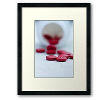 little red pills Framed Print