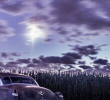 An old rusty 50's caddy in the moonlight by a cornfield Sticker