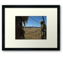 mountain scene through wire fences Framed Print