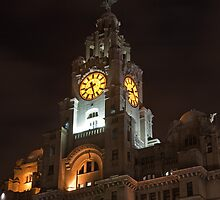 The Liver Building clock in Liverpool at Night by Keith Larby