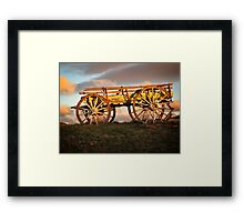 Old wagon in the sunset Framed Print