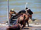 Launching the waka (canoe). New Zealand by Roy  Massicks