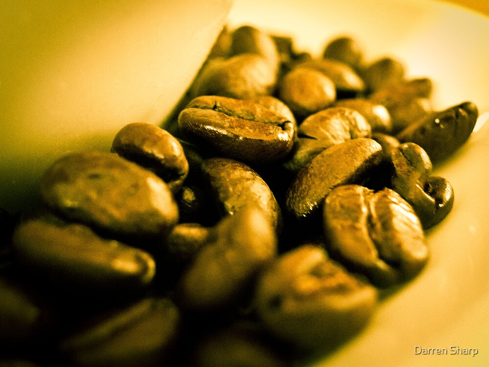 Golden coffee beans by Darren Sharp