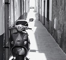Monochrome Moped Parked In Sunny Side Street by lisaclair