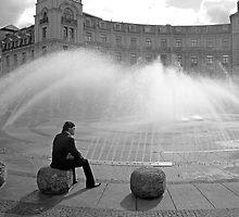 Man at Stachusbrunnen in Munich by Robert Meyers-Lussier
