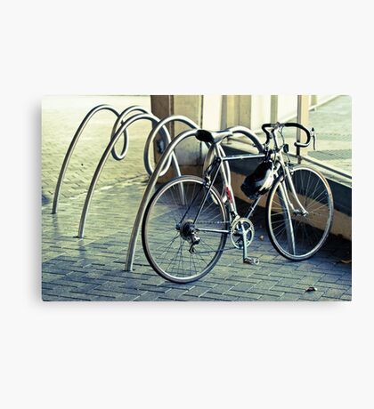 A bicycle race is comin your way.  Canvas Print