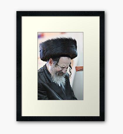 Praying in the Ohel of Rabbi Elimelech. Harcikn Dank ! A dank ojch zejer!   Featured in  Hat Heads. Framed Print