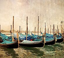 Beautiful gondolas at Venice waterfront. by cloud7