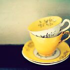 yellow teacups by Catherine  Regan