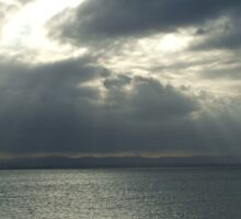 Sunray Peaking Through Clouds At Scabrorough Sticker