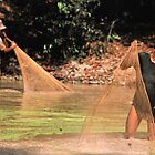 Khmer fisherman in the Angkor complex. by Phil Bower