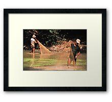 Khmer fisherman in the Angkor complex. Framed Print