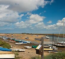 Boats on water and on shore in Wells-next-the-sea Norfolk coast by Magdalena Warmuz-Dent