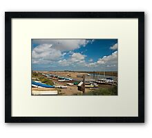 Boats on water and on shore in Wells-next-the-sea Norfolk coast Framed Print