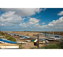 Boats on water and on shore in Wells-next-the-sea Norfolk coast Photographic Print