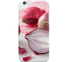 Shallots in the net on white wooden table iPhone Case/Skin